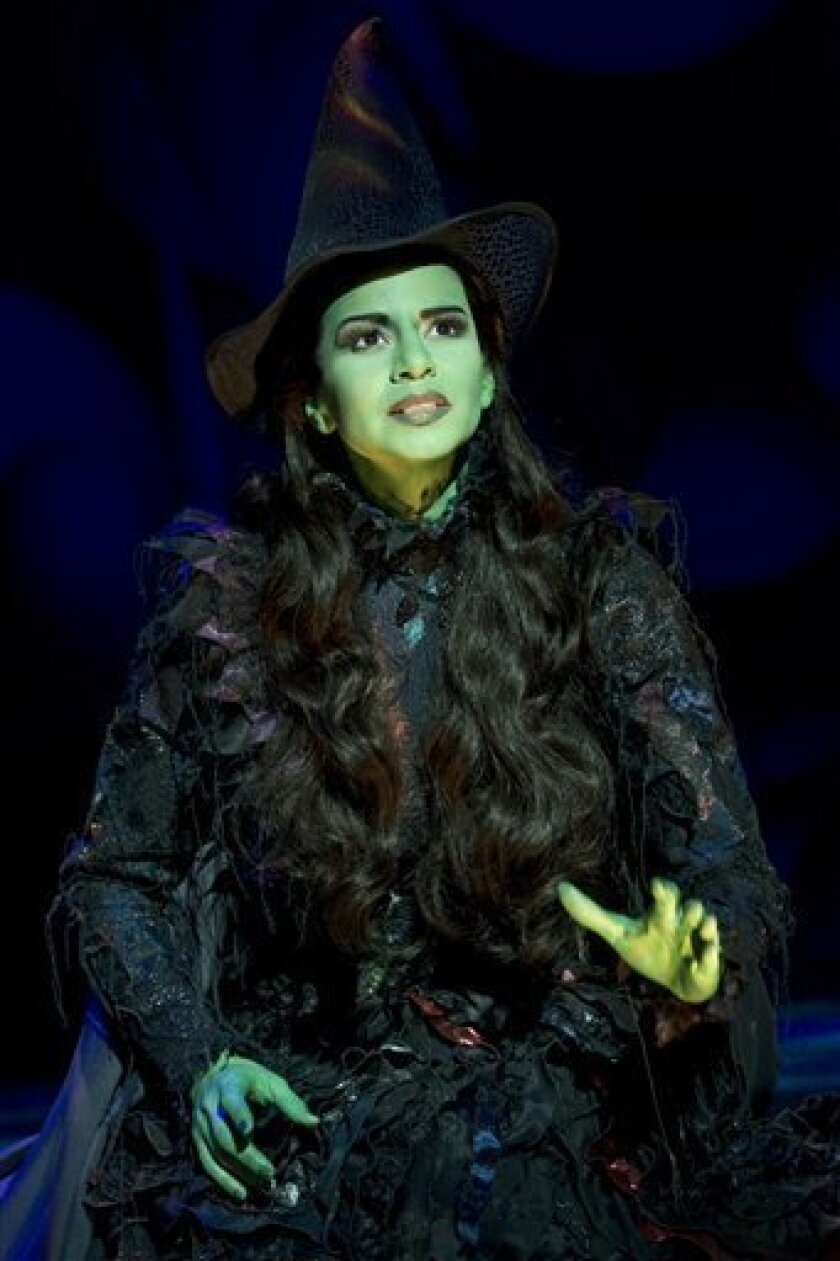 """In this theater publicity image released by The Hartman Group, Mandy Gonzalez portrays Elphaba in a scene from the Broadway musical """"Wicked."""" (AP Photo/The Hartman Group, Joan Marcus)"""
