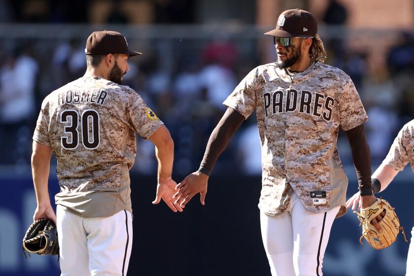 The Padres' Eric Hosmer celebrates with Fernando Tatis Jr.