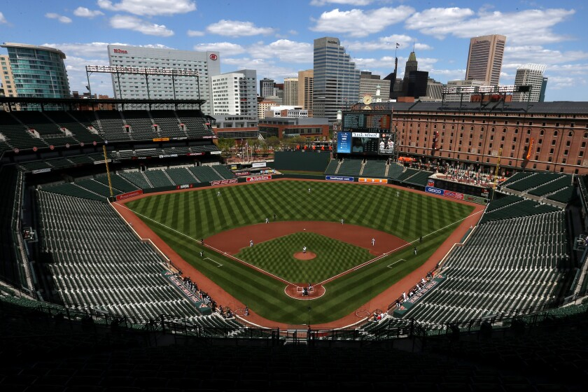Orioles pitcher Ubaldo Jiminez throws to White Sox batter Adam Eaton at an empty Camden Yards in 2015.