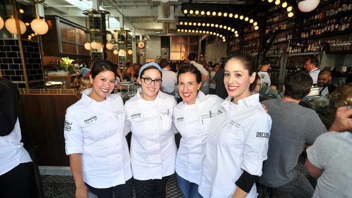 (from left) Chef Carmine Lopez wins Ironside's 2nd Annual Charity Shuck-A-Thon in a race against Claudette Wilkins, Katherine Humphus and Priscilla Curiel for charity on National Oyster Day.