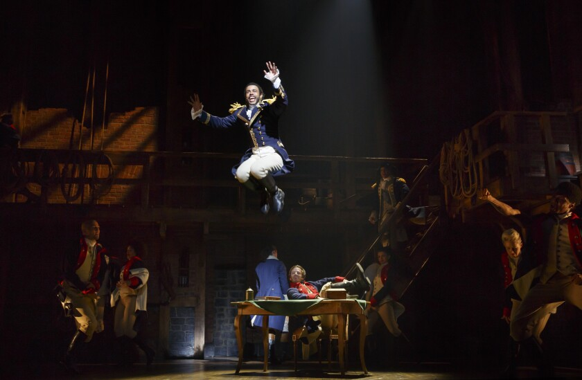 "Daveed Diggs (as the Marquis de Lafayette) leaps from a table in the musical ""Hamilton"""