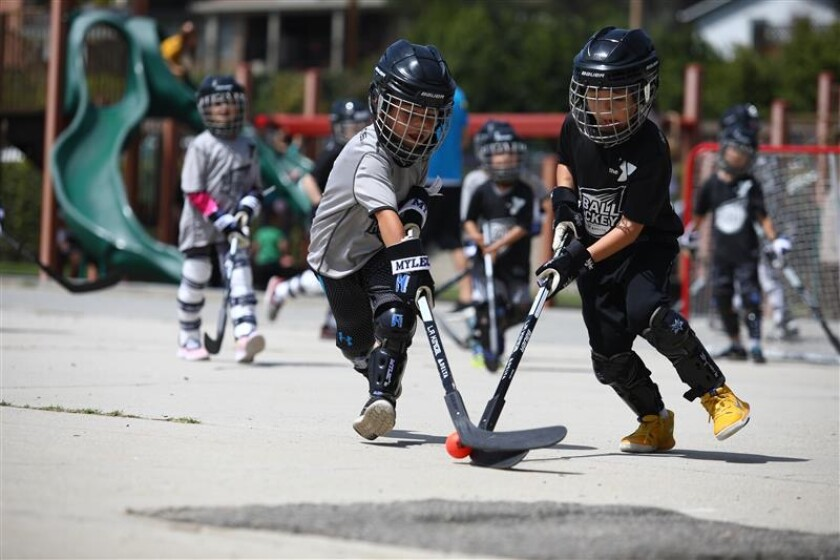 Children compete in street hockey leagues sponsored by the Los Angeles Kings.