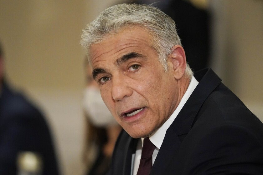 FILE - In this June 27, 2021 file photo, Israeli Foreign Minister Yair Lapid meets with Secretary of State Antony Blinken in Rome. Poland's government said Monday Aug. 16, 2021, that its ambassador to Israel will remain in Poland until further notice after Israel downgraded diplomatic ties with Warsaw and strongly criticized a new Polish law that restricts the rights of Holocaust survivors to reclaim property seized by the country's former communist regime. (AP Photo/Andrew Harnik, Pool, File)