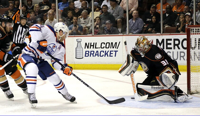 Ducks goalie Frederik Andersen saves a shot from Oilers' Taylor Hall during the Ducks' 5-1 win over the Oilers on April 1.
