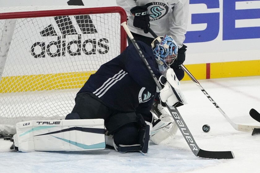 Seattle Kraken goalie Philipp Grubauer watches the puck as he takes part in a practice session, Thursday, Sept. 9, 2021, during a media event for the grand opening of the Kraken's NHL hockey practice and community facility in Seattle. (AP Photo/Ted S. Warren)