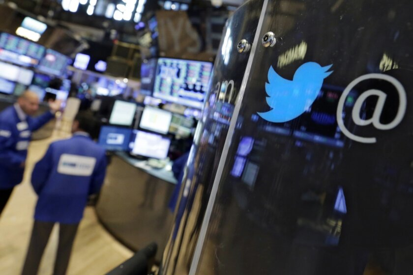 FILE - In this July 28, 2015 file photo, the logo for Twitter adorns a phone post on the floor of the New York Stock Exchange. Twitter's battered shares dipped below their IPO price on Thursday, Aug. 20, 2015, amid ongoing investor concerns about the company's ability to grow its user base. (AP Photo/Richard Drew)