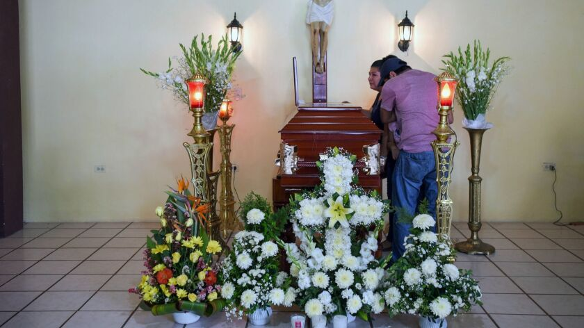 Relatives of mourn slain Mexican journalist Leobardo Vazquez Atzin during his funeral in Papantla, Veracruz state, on March 22, 2018.