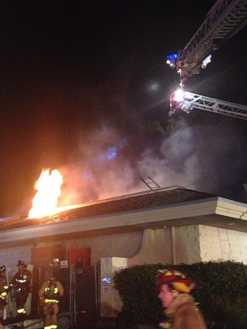 Flames coming from the roof at  K Sandwiches, a popular Vietnamese sandwich shop near Mesa College.