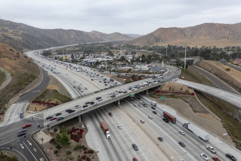 An aerial view of traffic on a freeway interchange