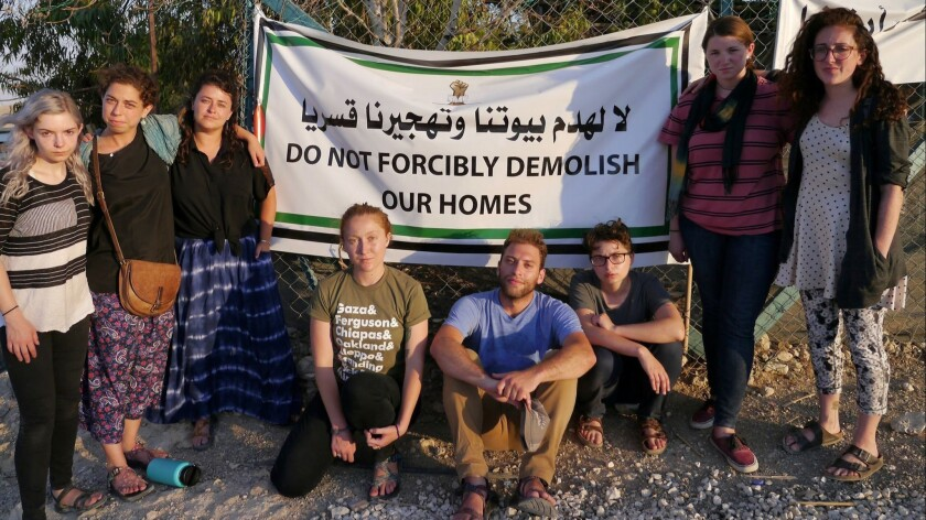 Participants who walked off from their Birthright trip visit Khan al Ahmar, a Bedouin village in the
