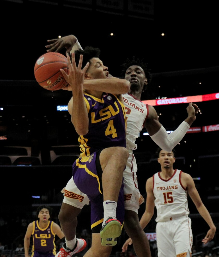 USC guard Jonah Mathews strips the ball from LSU guard Skylar Mays during the first half of a game on Dec. 21, 2019, at Staples Center.