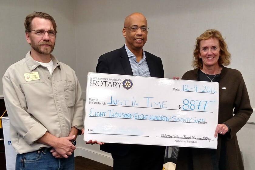 The check presentation to Just in Time for Foster Youth. DMSB Rotary President Liam Murphy and Community Service Chair Susan Hennenfent present a check for $8,877 to (center) Don Wells, executive director of Just in Time for Foster Youth.
