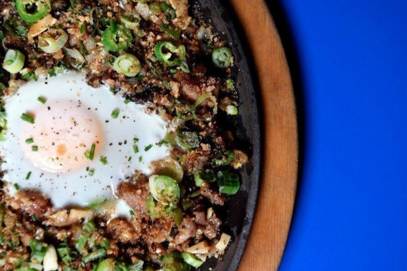 LOS ANGELES, CA-January 14,2019: Inside the Ma'am Sir on Monday, January 14, 2019. The Pork Sisig (with egg): Sweetbreads, Maui Onions, Serrano Chile, Green Onion, Calamansi.(Mariah Tauger / Los Angeles Times)