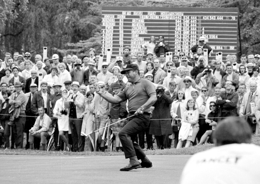 Lee Trevino reacts as his putt on the 11th hole drops for a birdie in final round of the 1968 U.S. Open.