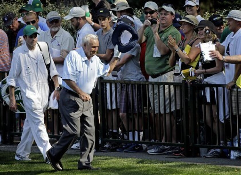 Arnold Palmer waves to spectators during the par three competition before the Masters golf tournament Wednesday, April 10, 2013, in Augusta, Ga. (AP Photo/David J. Phillip)