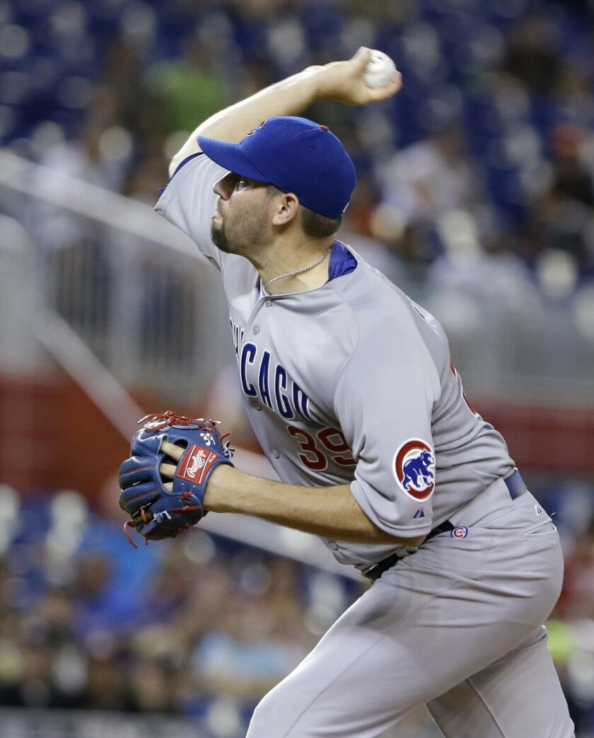 Chicago Cubs' Jason Hammel delivers a pitch during the first inning of a baseball game against the Miami Marlins, Monday, June 1, 2015, in Miami. (AP Photo/Wilfredo Lee)