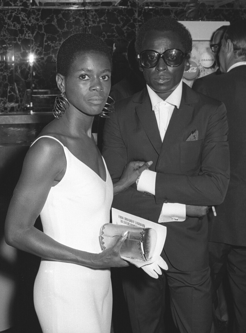 B&W shot of Cicely Tyson and Miles Davis looking incredibly cool in the 60s