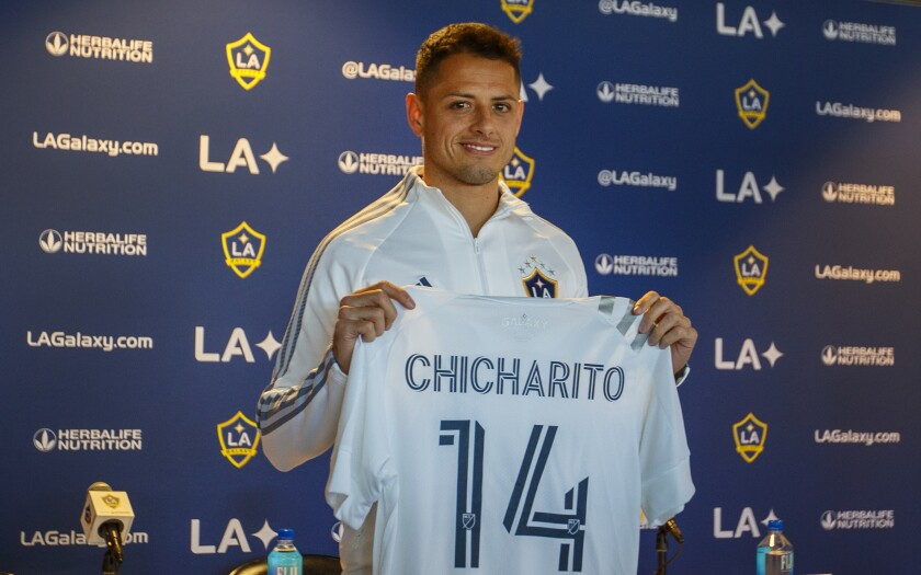 "Javier ""Chicharito"" Hernandez holds up his new Galaxy jersey at a news conference Jan. 23, 2020, introducing him."