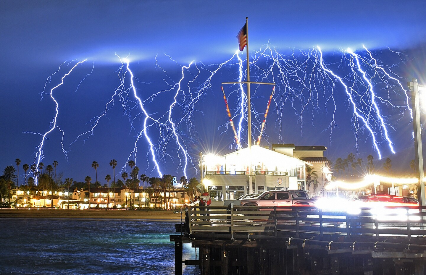 A time exposure captures a series of lightning strikes as seen from Stearns Wharf in Santa Barbara. The photographer used a cable release and a time exposure of between 15 and 75 seconds at an f/11 aperture.