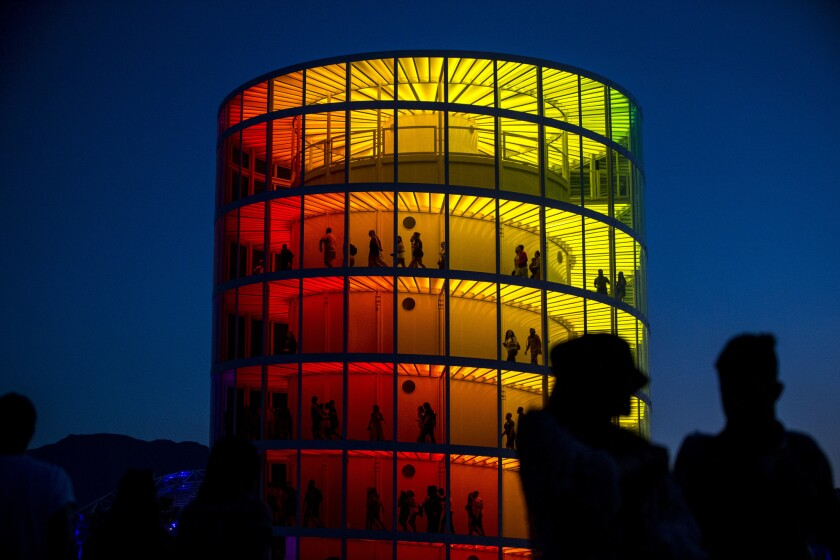 INDIO, CALIF. - APRIL 13: People are seen walking inside of the Spectra art installation by Newsubst