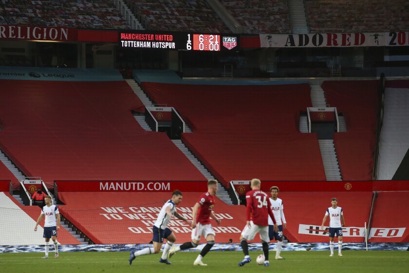 A display shows the score in the last minutes of the English Premier League soccer match between Manchester United and Tottenham Hotspur at Old Trafford in Manchester, England, Sunday, Oct. 4, 2020. (Alex Livesey/Pool via AP)