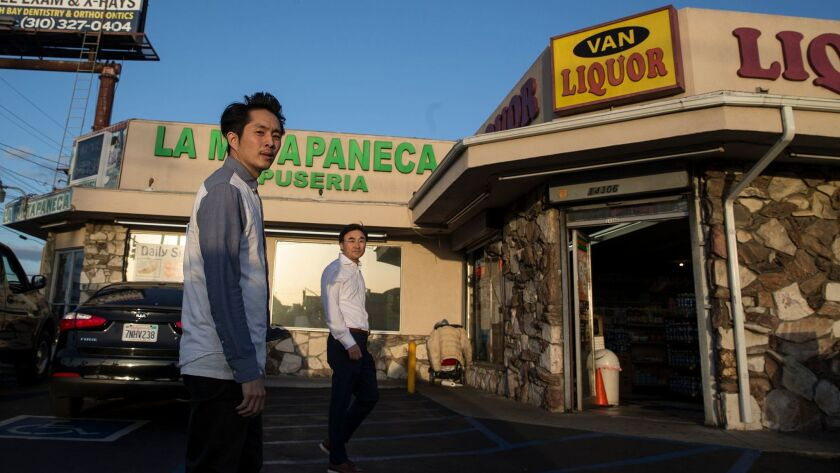 """Justin Chon, left, and his father, Sang Chon, at one of the sites where Justin filmed the movie """"Goo"""