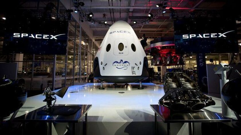 In 2014, SpaceX unveiled a version of its Dragon spacecraft that would accommodate a crew.