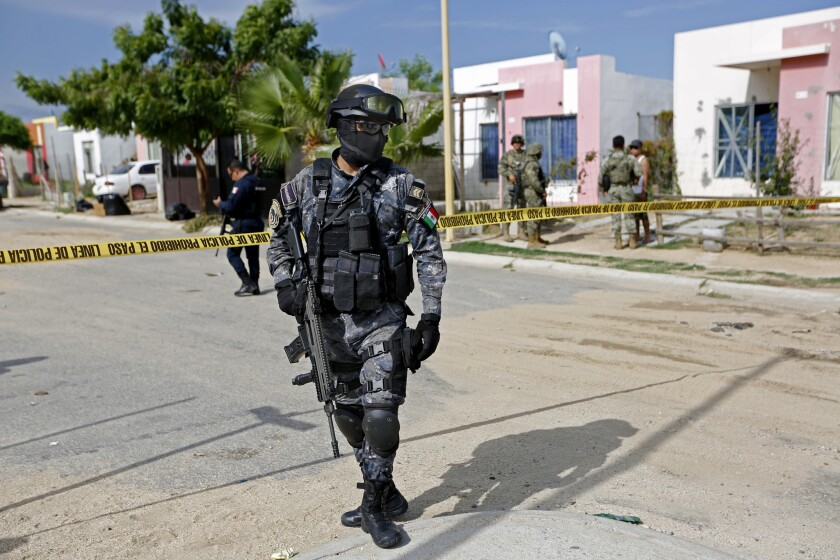 A Mexican federal police officer at the scene of a homicide in Los Cabos, Mexico, in 2017.