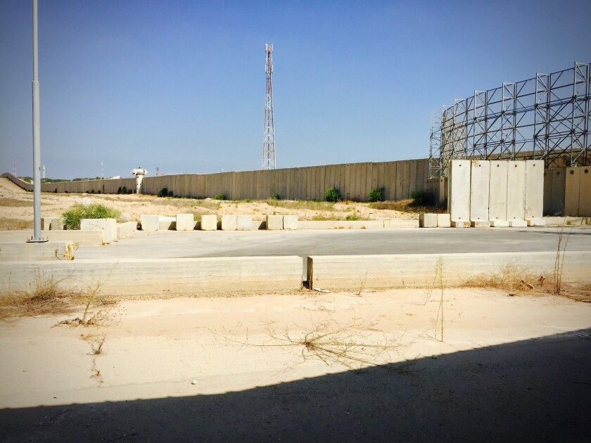 The concrete wall that surrounds the Gaza Strip is shown in 2015.
