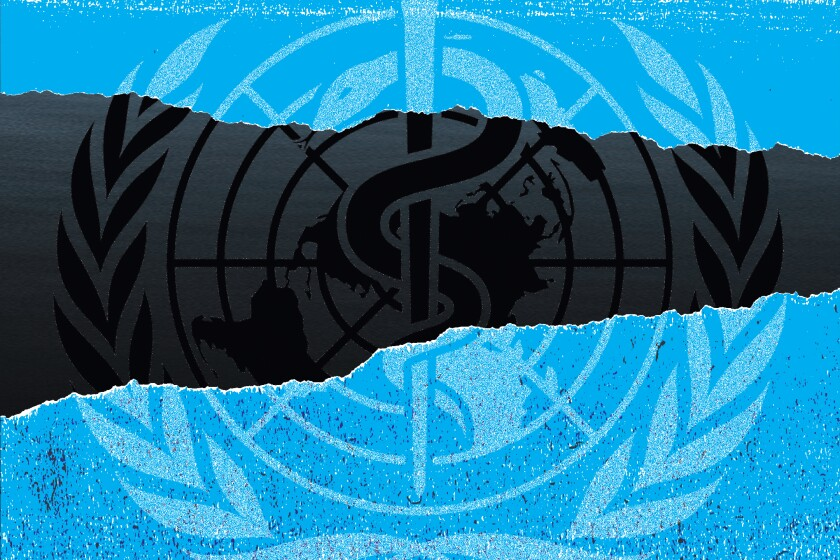 Photo illustration of the World Health Organization logo on a torn blue background with black background underneath.