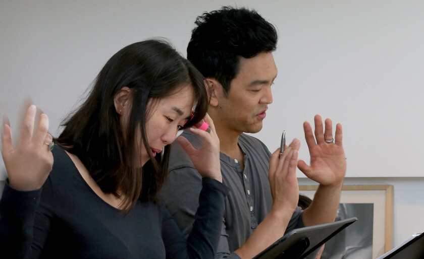 Actors Kerri Higuchi and John Cho during a recent reheasal. Artist at Play also holds a summer salon in which plays usually cast with white actors are presented as staged readings with Asian actors.