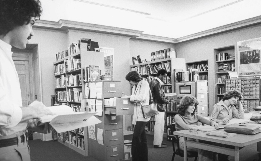 AFI Fellows, including Edward Zwick, left, conduct research in the library at Greystone in 1976.