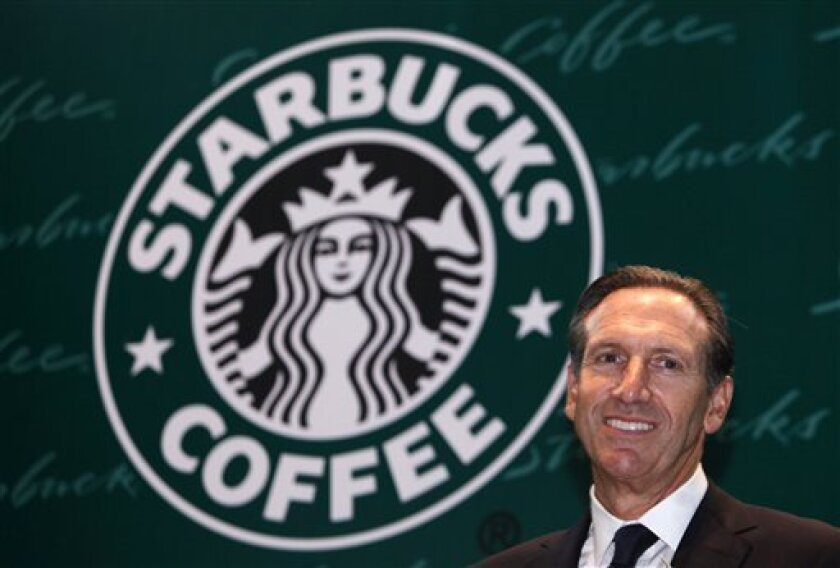 In this April 15, 2010 file photo, Starbucks Corp. CEO Howard Schultz smiles during a ceremony marking the 10th anniversary of the first open Starbucks coffee shop in Hong Kong. Starbucks Corp., releases quarterly earnings Thursday, Nov. 4, 2010 after the market close. (AP Photo/Kin Cheung, file)