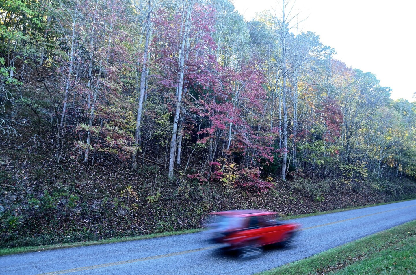 A red sports car zips past the outskirts of Roanoke, Va., on Oct 21.