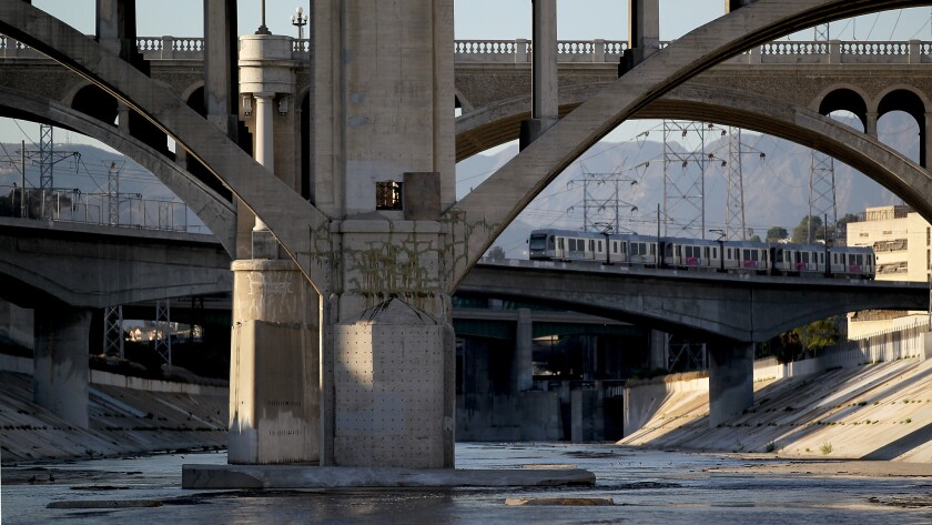 A Metro Gold Line train crosses the Los Angeles River near downtown L.A.