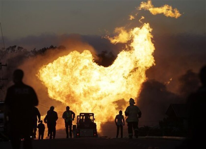 A massive fire is roars through a mostly residential neighborhood in San Bruno, Calif., Thursday, Sept. 9, 2010. Firefighters from San Bruno and surrounding cities are battling the blaze that started on a hillside and is now consuming homes in a residential neighborhood. (AP Photo/Paul Sakuma)