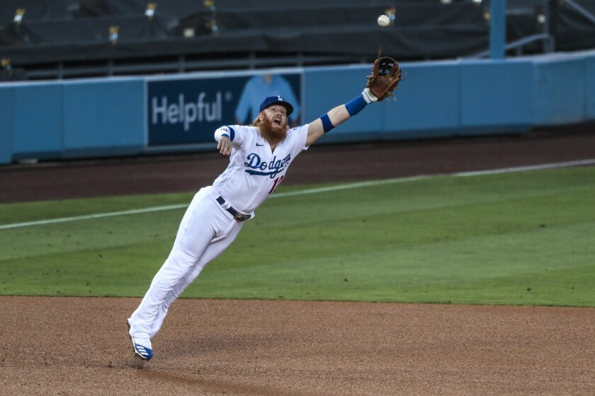 Dodgers third baseman Justin Turner can't haul in a liner hit by Giants first baseman Darin Ruf.
