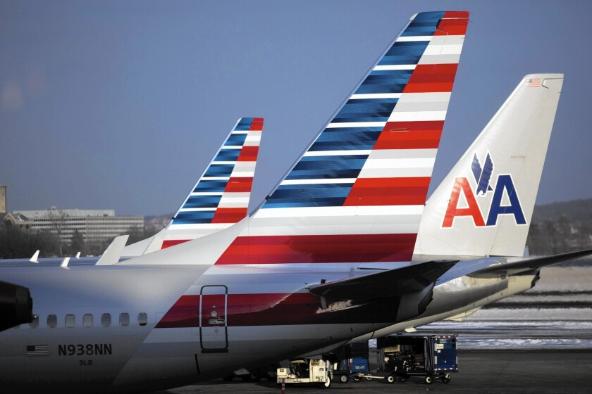 American Airlines, which merged with US Airways, last year adopted that carrier's policy of not hedging against spikes in fuel prices, allowing American to take full advantage of the steep plunge in fuel prices. Above, American planes at Ronald Reagan National Airport in Washington, D.C.