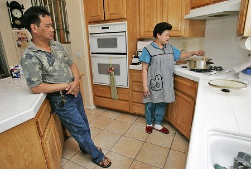 Carlito and Marilyn Velonza of Chula Vista turned over ownership of two houses to Amerisian Trust,  a venture that offers to help homeowners modify their mortgages. (John Gibbins / Union-Tribune)