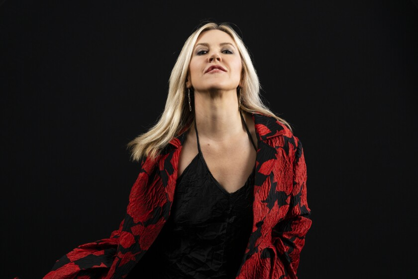"This Oct. 4, 2019 photo shows singer-songwriter Liz Phair posing for a portrait to promote her memoir ""Horror Stories,"" in Los Angeles. (Photo by Willy Sanjuan/Invision/AP)"