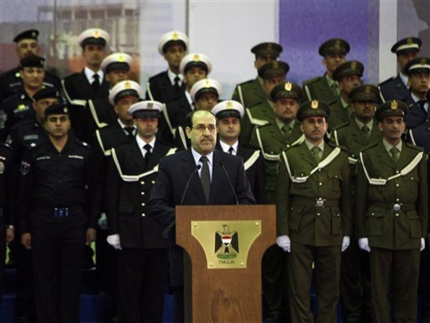 Iraqi Prime Minister Nouri al- Maliki speaks to his supporters in Baghdad, Iraq. Saturday, Dec. 31, 2011. Iraq's prime minister says the end of the American military presence in Iraq is a new dawn for his country. (AP Photo/Karim Kadim)