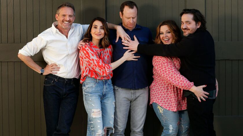 """Stars of TV series """"Nobodies"""" Hugh Davidson, left, Rachel Ramras and Larry Dorf are shown with the show's executive producers Melissa McCarthy and Ben Falcone at Warner Bros. Studios in Burbank."""