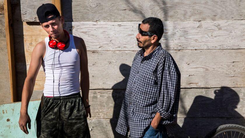 TIJUANA, B.C., MEX - FEBRUARY 01: Residents Alexis Franco Santana and Juan Manuel Hernandez Lozano,