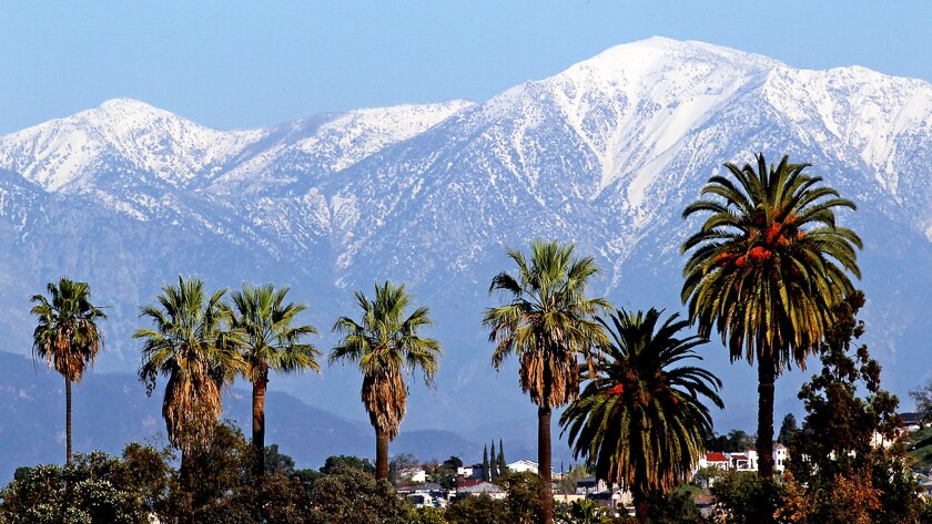 Snow-covered San Gabriel mountains are seen from Boyle Heights in December 2012.