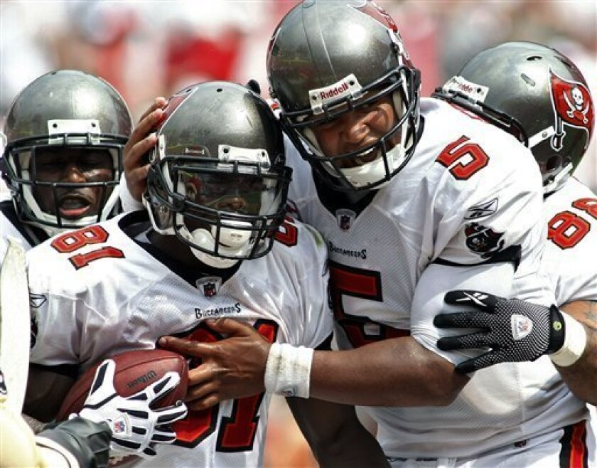 Tampa Bay Buccaneers wide receiver Micheal Spurlock (81) celebrates with teammates, including Tampa Bay Buccaneers' Josh Freeman (5) after catching what prove to be the game-winning touchdown pass during the fourth quarter of an NFL football game against the Cleveland Browns Sunday, Sept. 12, 2010, in Tampa, Fla. (AP Photo/Brian Blanco)