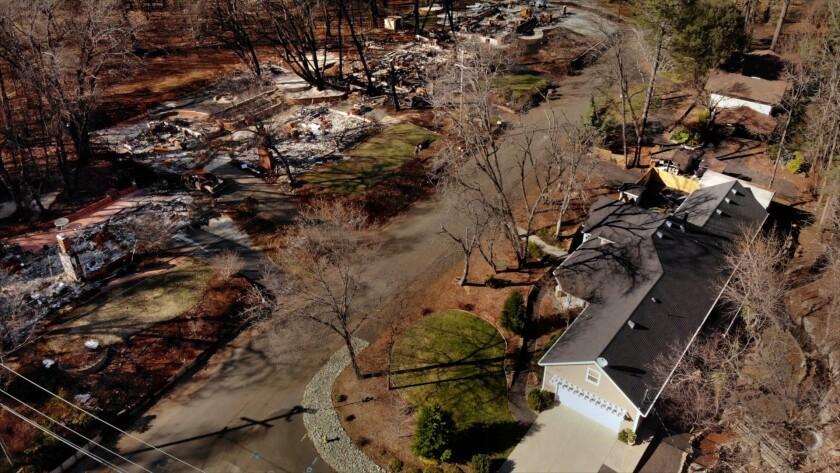 PARADISE, CALIFORNIA--FEB. 25, 2019--The Brennan home is bottom right. Josh Brennan, age 45, left, a