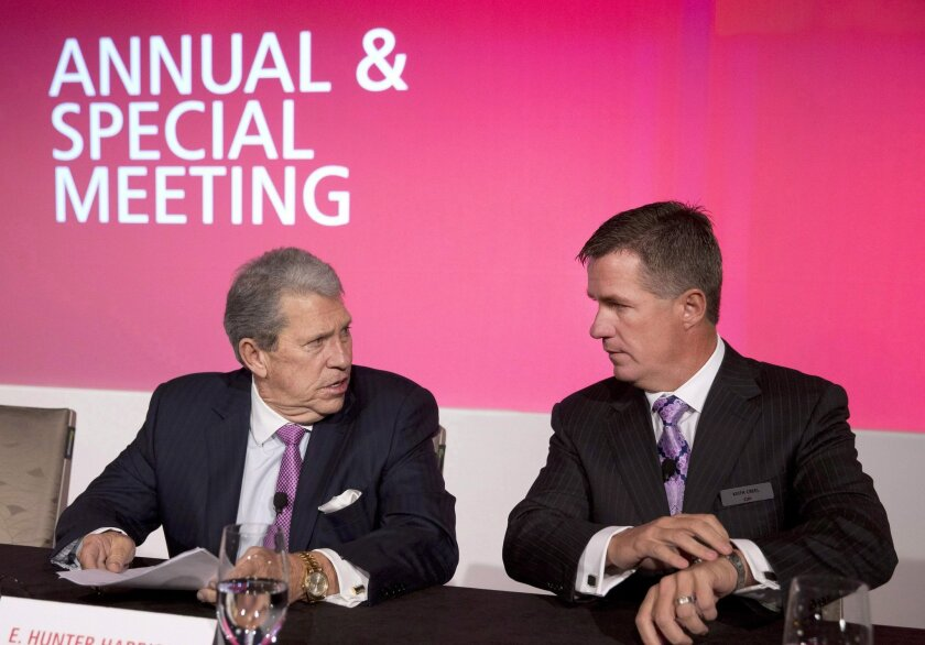 In a Thursday, May 14, 2015 photo, Canadian Pacific Railway CEO Hunter Harrison, left, chats with President & COO Keith Creel at the company's AGM in Calgary. Canadian Pacific Railway says Creel will succeed Harrison on July 1, 2017.  (Larry MacDougal/The Canadian Press via AP)