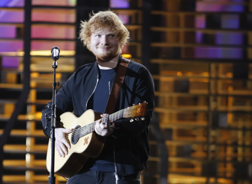 "English singer-songwriter Ed Sheeran is named in a $20-million copyright infringement lawsuit filed Wednesday, June 8, in Los Angeles. It alleges that his hit ""Photograph"" borrowed key elements of its chorus from an earlier song, ""Amazing."""