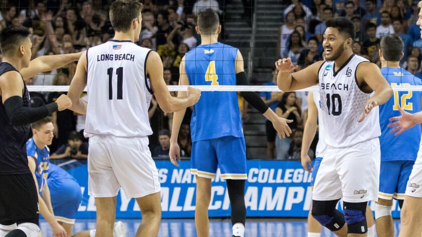 Long Beach State's TJ DeFalco (11) and Josh Tuaniga celebrate after scoring against UCLA in the NCAA national championship game on May 5, 2018. LBSU won 3-2 to take the national title ending a 17-year drought.