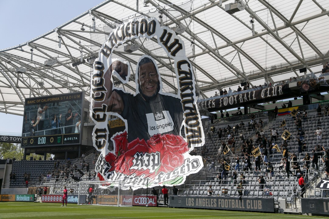 A giant banner with Mauricio's photo